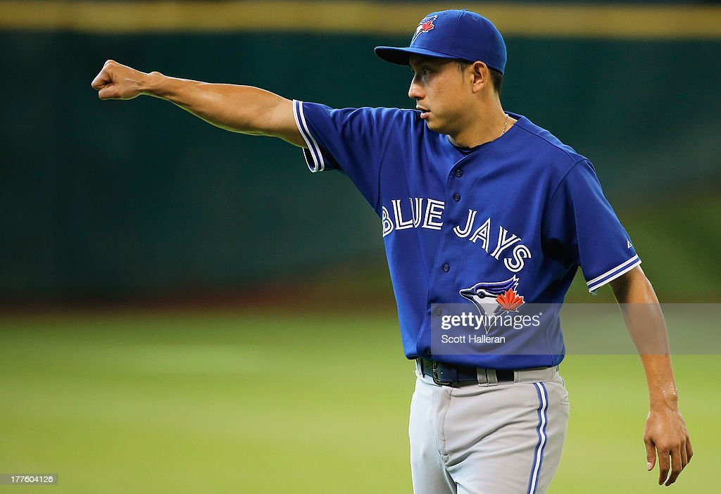 Munenori Kawasaki #66 of the Toronto Blue Jays works out on the field before the game against the Houston Astros at Minute Maid Park on August 24, 2013 in Houston, Texas.