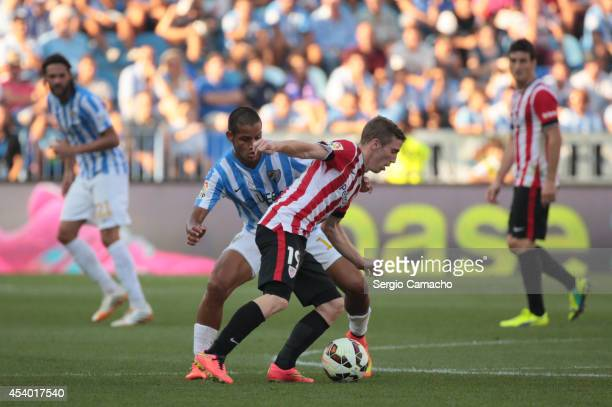 Muniain of Athletic Club Bilbao duels for the ball whit Rosales of Malaga CF during the La Liga match between Malaga CF and Athletic Club Bilbao at...