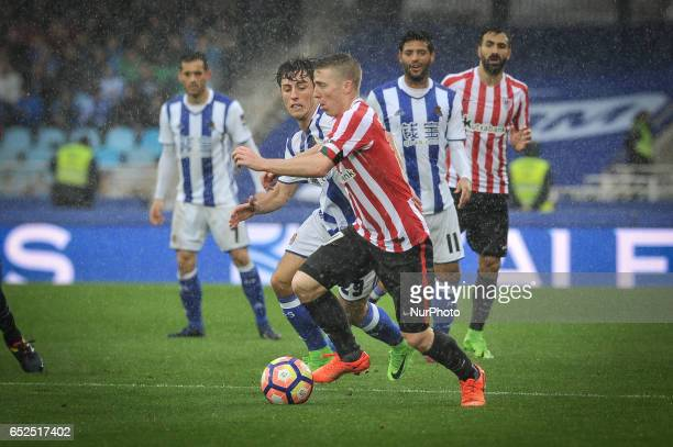 Muniain of Athletic Club duels for the ball with Álvaro Odriozola of Real Sociedad during the Spanish league football match between Real Sociedad and...