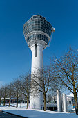 Munich airport tower on a clear winter day