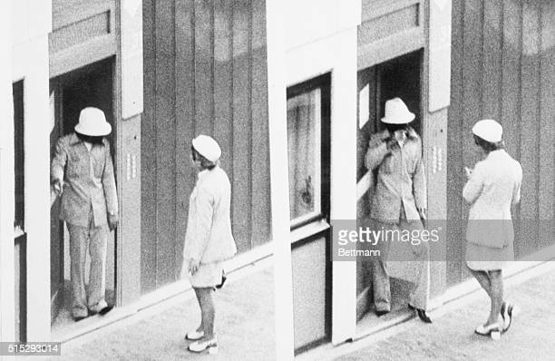 An Arab guerrilla looks around after opening the door for a West German policewoman who is acting as a communicator between West German authorities...