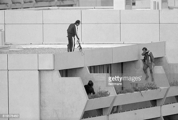 Armed police drop into position on a terrace directly above the apartments where between nine and 26 members of the Israeli Olympic team are being...