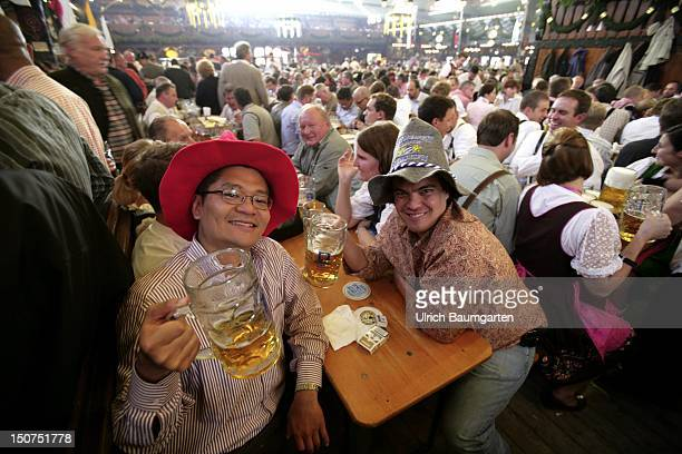 GERMANY MUNICH Munich Beer Festival Oktoberfest Muenchen Our picture shows Munich Beer Festival visitors from all over the world in Munich