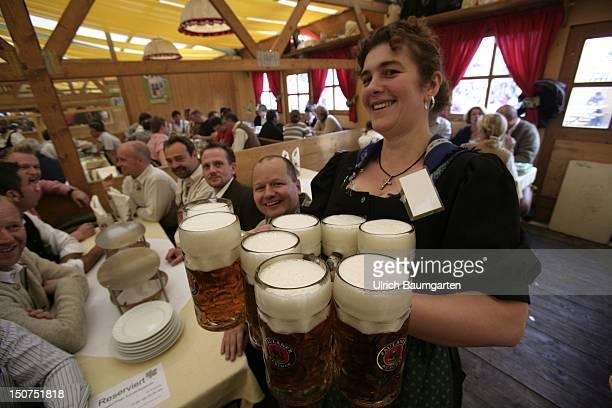 GERMANY MUNICH Munich Beer Festival Oktoberfest Muenchen Strong achievement waitress with eight beer mugs at the Munich Beer Festival