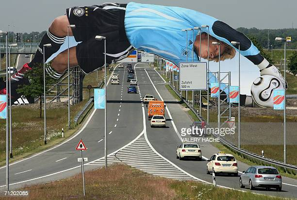 A giant billboard of German goalkeeper Oliver Kahn stretches over the road leading from Munich's international airport into the city 14 June 2006...