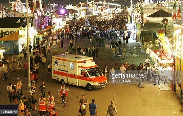 An ambulance drives through the illuminated Theresienwiese meadow during the opening's evening of the traditional Oktoberfest beer festival 16...