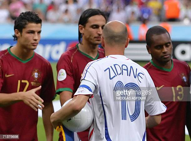 France's captain Zinedine Zidane shakes hands with Portugal's Cristiano Ronaldo Fernando Meira and Miguel before the start of the World Cup 2006 semi...