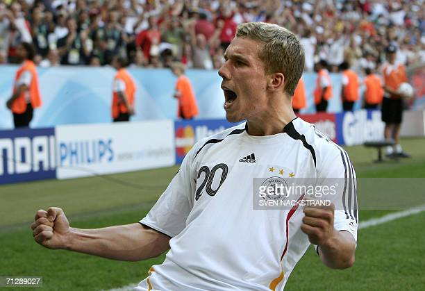 German forward Lukas Podolski goes to his knees as he celebrates scoring his second goal in the first half during the round of 16 World Cup football...