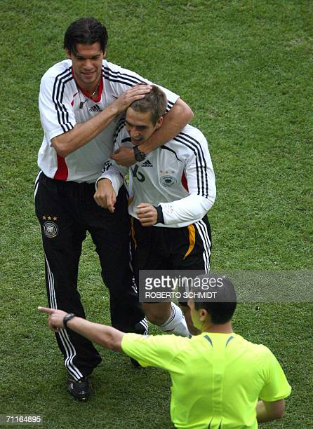 German midfielder Michael Ballack congratulates teammate Philipp Lahm after the latter scored the first goal against Costa Rica in the first half of...