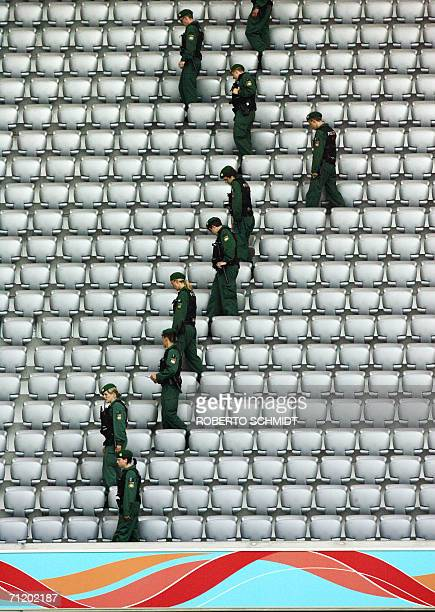 German police perform a security sweep ahead of the first round Group H World Cup football match between Tunisia and Saudi Arabia at Munich's World...