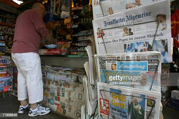 Newspapers on display sport front pages featuring Pope Benedict XVI at at newsstand in Munich 10 September 2006 A day after arriving in Bavaria the...