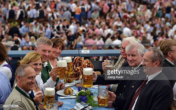Munich new Mayor Dieter Reiter and his wife Petra Reiter clink beer mugs with Bavarian Governor Horst Seehofer his wife Karin Seehofer and former...