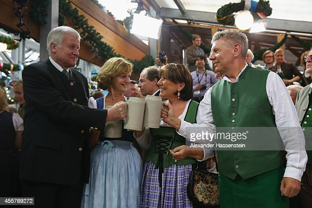 Munich new Mayor Dieter Reiter and his wife Petra Reiter clink the first beer mugs with Bavarian Governor Horst Seehofer and his wife Karin Seehofer...
