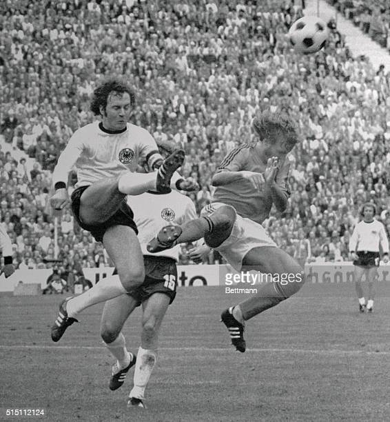 West German skipper Franz Beckenbauer ends another Dutch attack with a sure footed clearance in the World Cup final game at the Olympic Stadium The...