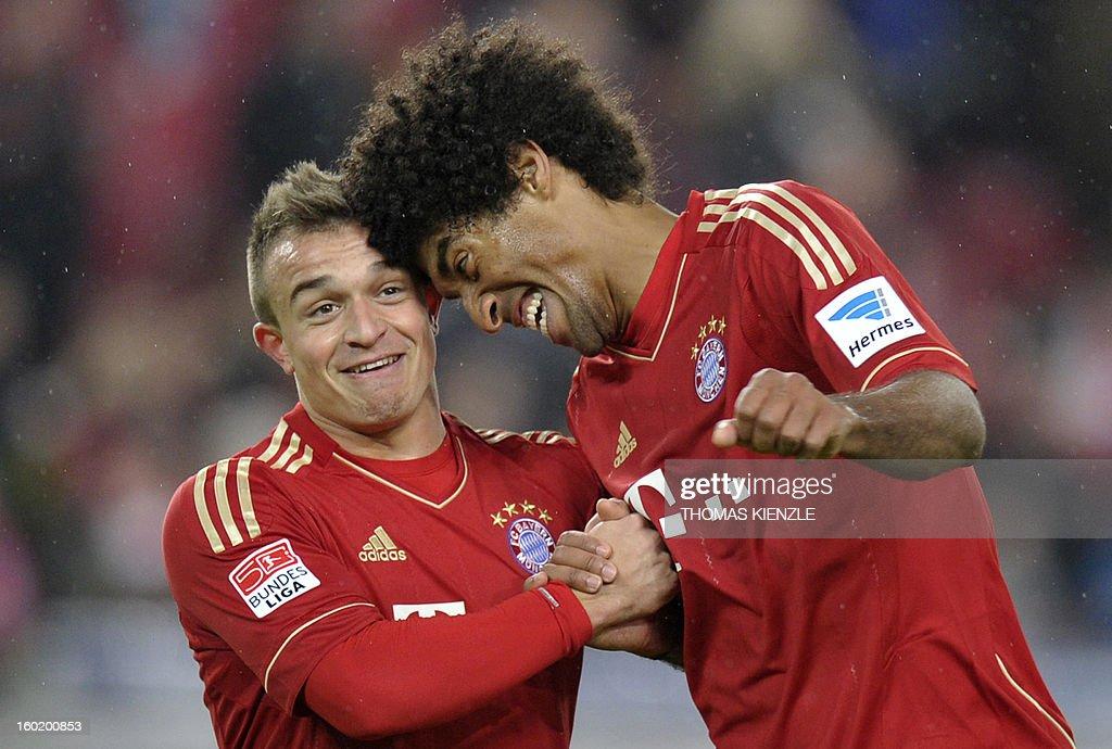 Munich's Brazilian defender Dante (R) and Swiss midfielder Xherdan Shaqiri react after the German first division Bundesliga football match between VfB Stuttgart and Bayern Munich in Stuttgart, southwestern Germany, on January 27, 2013. Bayern Munich won the match 0-2.