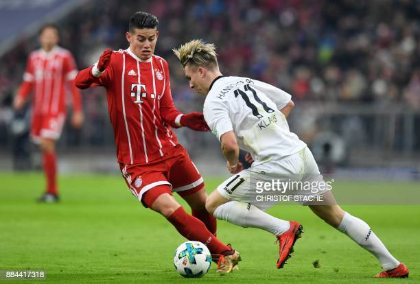 Munich's Colombian James Rodriguez and Hanover's midfielder Felix Klaus vie for the ball during the German First division Bundesliga football match...