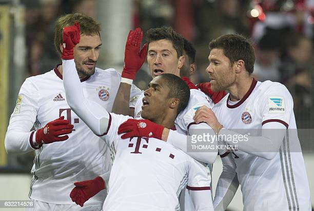 Munich's defender Mats Hummels Brazilian forward Douglas Costa Polish forward Robert Lewandowski and Spanish midfielder Xabi Alonso celebrate after...