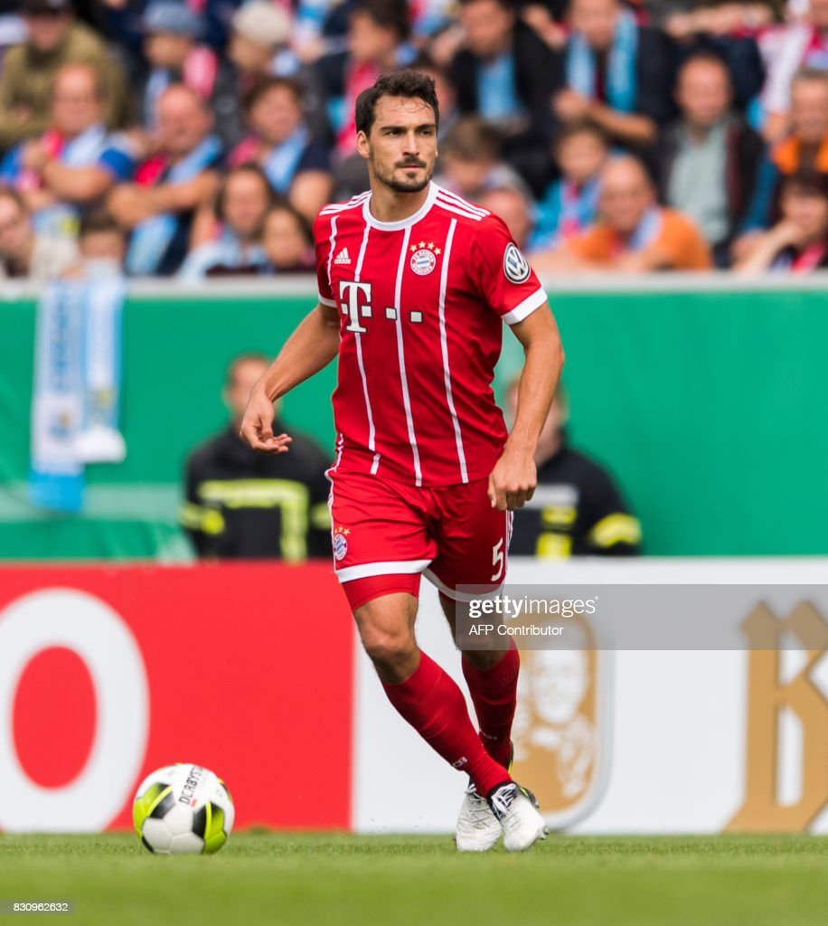 Munich's defender Mats Hummels plays the ball during the German football Cup DFB Pokal first round match between German third division football club Chemnitzer FC and German first division football club FC Bayern Munich in Chemnitz eastern Germany, on August 12, 2017.