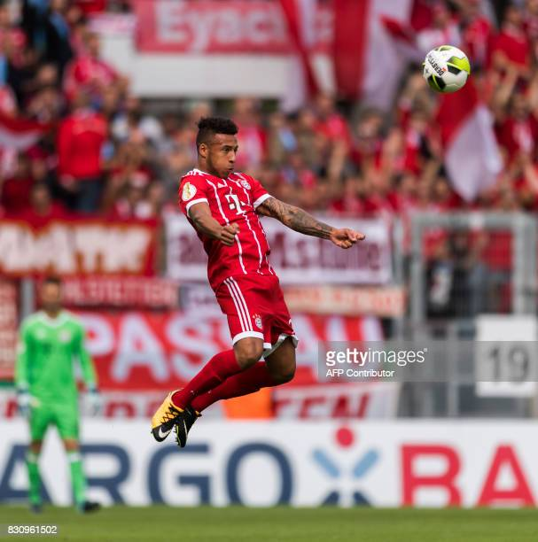 Munich's French midfielder Corentin Tolisso plays the ball during the German football Cup DFB Pokal first round match between German third division...