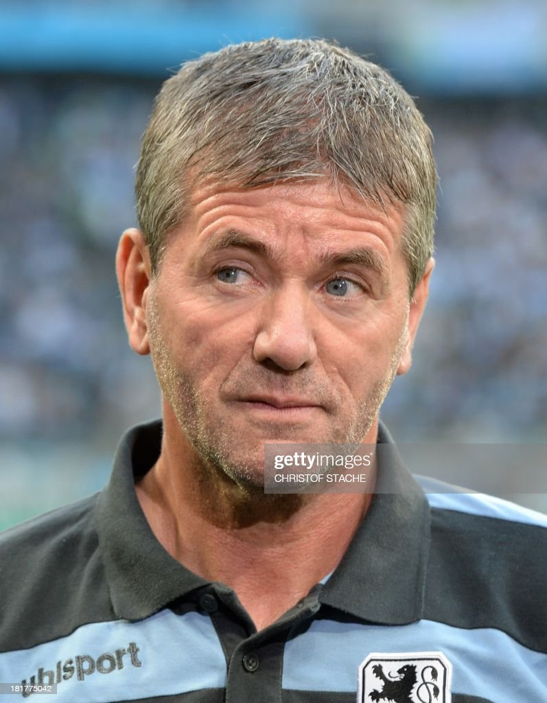 Munich's headcoach Friedhelm Funkel is seen during the second round football match of the German Cup (DFB - Pokal) TSV 1860 Munich vs Borussia Dortmund on September 24, 2013 in Munich, southern Germany.