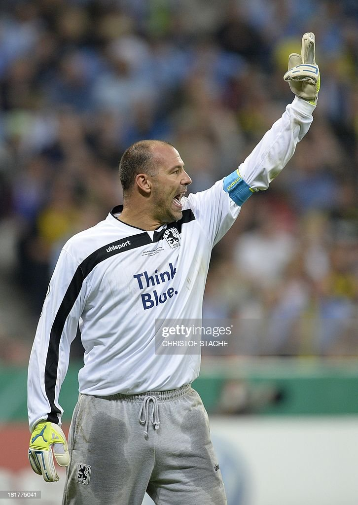 Munich's Hungarian goalkeeper Gabor Kiraly reacts during the second round football match of the German Cup (DFB - Pokal) TSV 1860 Munich vs Borussia Dortmund on September 24, 2013 in Munich, southern Germany.