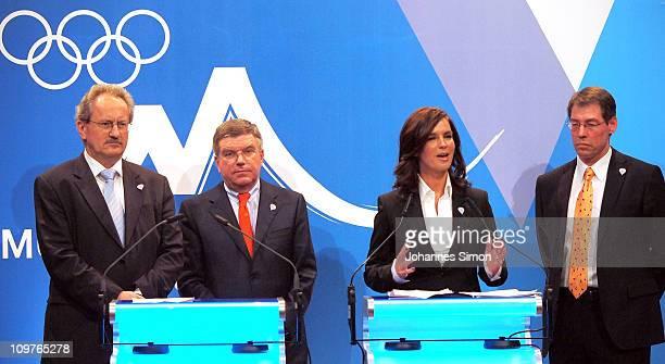 Munich's lord mayor Christian Ude Thomas Bach head of the German NOC Katarina Witt and Bernhard Schwank representatives of the Munich bid address the...