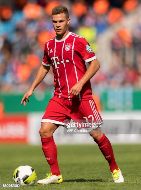 Munich's midfielder Joshua Kimmich plays the ball during the German football Cup DFB Pokal first round match between German third division football...