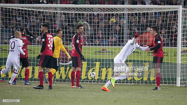 Munich's Polish forward Robert Lewandowski celebrates after he scored during the German first division Bundesliga football match SC Freiburg vs FC...