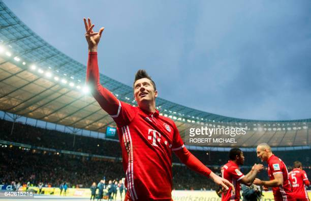 Munich´s Polish forward Robert Lewandowski celebrates after scoring during the German First division Bundesliga football match Hertha Berlin vs...