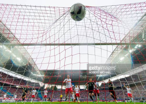 Munich´s Polish forward Robert Lewandowski scores the third goal for his team during the German first division Bundesliga football match between RB...