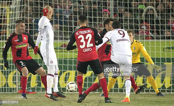 Munich's Polish forward Robert Lewandowski scores the winning goal during the German first division Bundesliga football match SC Freiburg vs FC...