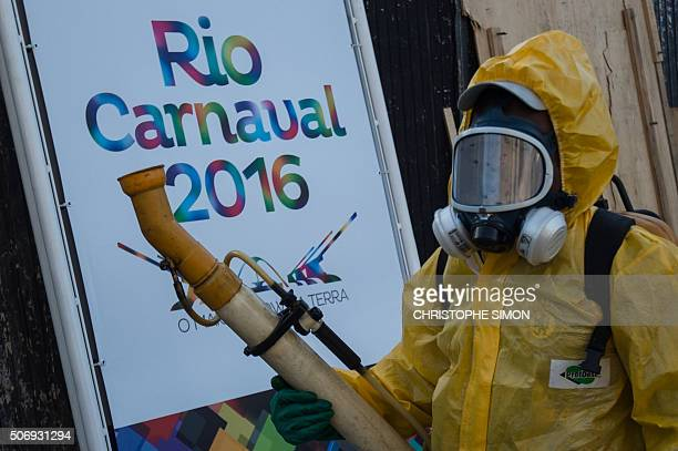 A municipal agent sprays anti Zika mosquitos chimical product at the sambadrome in Rio de Janeiro on January 26 2016 Brazil is mobilizing more than...