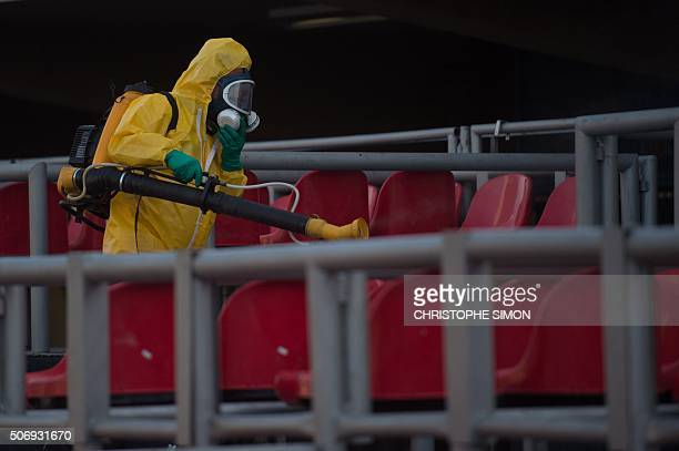 A municipal agent sprays anti Zika mosquitos chimical product at the sambadrome in Rio de Janeiro on January 25 2016 Brazil is mobilizing more than...