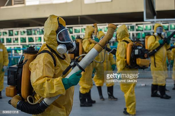 Municipal agents spray anti Zika mosquitos chimical product at the sambadrome in Rio de Janeiro on January 26 2016 Brazil is mobilizing more than...