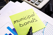Municipal bond written on a memo stick and documents.