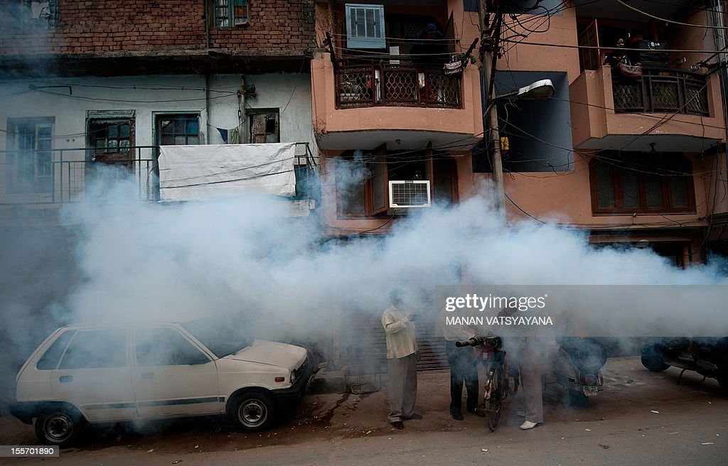 Municipal health workers fumigate a neighbourhood against mosquitoes in New Delhi on November 7, 2012. Dengue continued to spread in the Indian capital with 39 fresh cases being reported November 7, taking the toll of people detected with the mosquito-borne disease this season to 1,288, according to Press Trust of India (PTI).