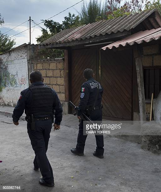 Municipal police officers pass by the house of Gisela Mota the mayor who was gunned down a day after taking office in Temixco Morelos State Mexico on...