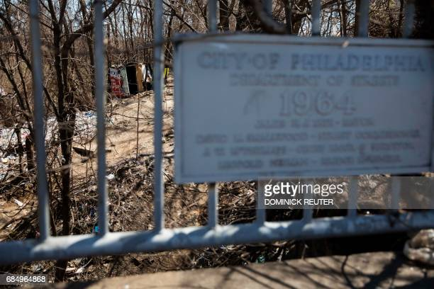 A municipal sign is seen on the 2nd Avenue Bridge that passes over a heroin encampment in the Kensington neighborhood of Philadelphia Pennsylvania on...