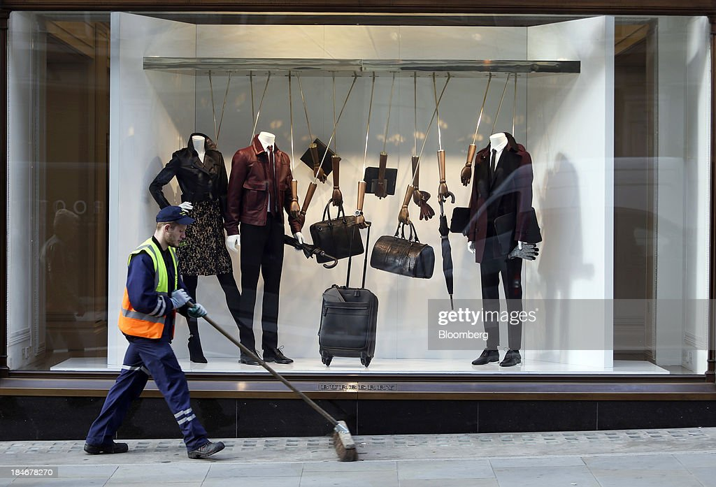 A municipal street worker cleans the pavement outside Burberry Group Plc's luxury clothing store on Regent Street in London, U.K., on Tuesday, Oct. 15, 2013. Burberry named Christopher Bailey as chief executive officer to succeed Angela Ahrendts who will leave in 2014 to work as a senior vice president at Apple Inc. Photographer: Chris Ratcliffe/Bloomberg via Getty Images