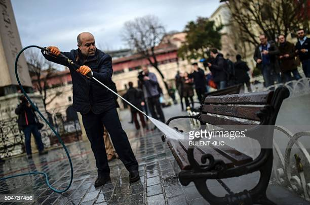 TOPSHOT A municipal worker cleans a bench at the site of a blast in Istanbul's tourist hub of Sultanahmet on January 13 2016 A Syrian suicide bomber...