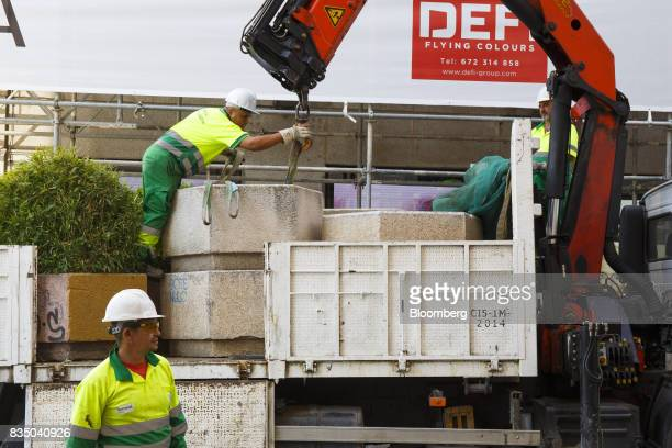 Municipal workers place street furniture on Puerta del Sol street as a security measure to prevent vehicle access in Madrid Spain on Friday Aug 18...