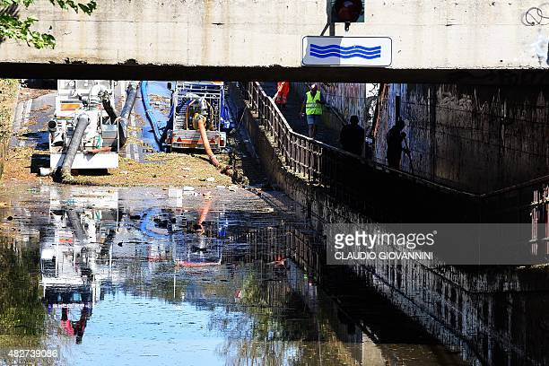 Municipal workers work in an underpass road damaged by a tornado in downtown Florence on August 2 2015 Some twenty people were wounded on August 1...