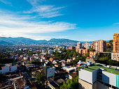Wispy clouds over the buildings in the municipality of Medellin in Colombia.