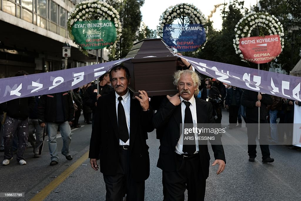Municipality workers carring a coffin demonstrate against the new austerity measures in Athens on November 22, 2012.