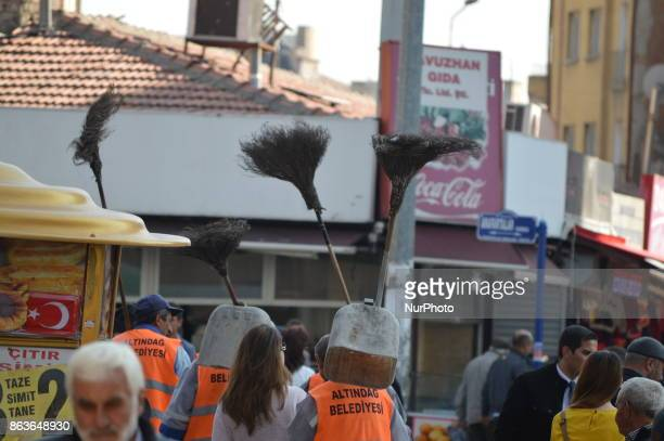 Municipality workers carry brooms in the historic Ulus district of Ankara Turkey on October 20 2017