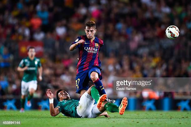Munir competes for the ball with Jose Juan Vazquez of Club Leon during the Joan Gamper Trophy match between FC Barcelona and Club Leon at Camp Nou on...