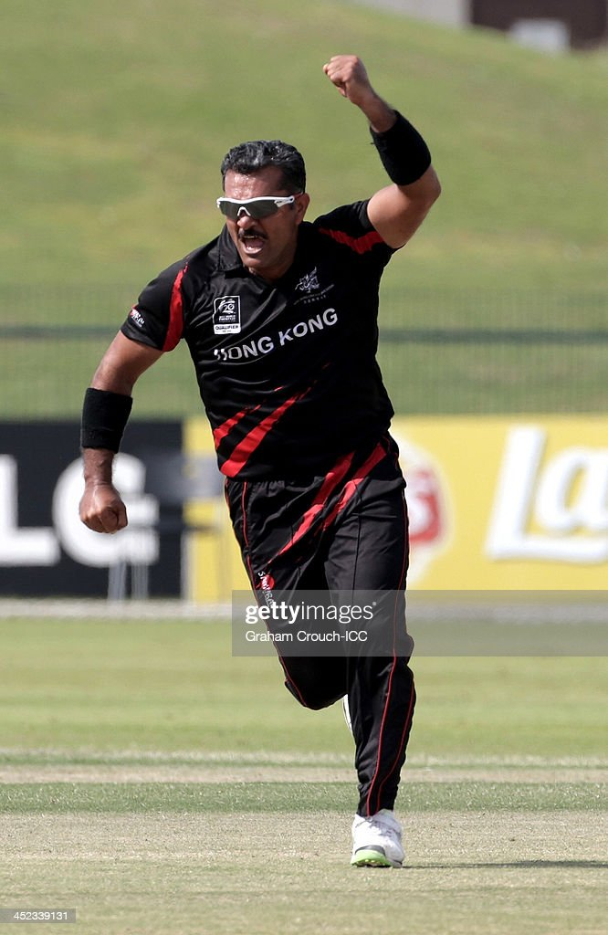 Munir Dar of Hong Kong celebrates his catch off his own bowling during the Papua New Guinea v Hong Kong Quarter Final match at the ICC World Twenty20 Qualifiers at the Zayed Cricket Stadium on November 28, 2013 in Abu Dhabi, United Arab Emirates.