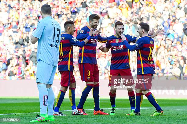 Munir el Haddadhi celebrates with his teammates Neymar Gerard Pique and Lionel Messi of FC Barcelona after scoring his team's second goal of FC...