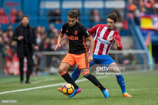 Munir El Haddadi Mohamed of Valencia CF competes for the ball with Sime Vrsaljko of Atletico de Madrid during the match Atletico de Madrid vs...