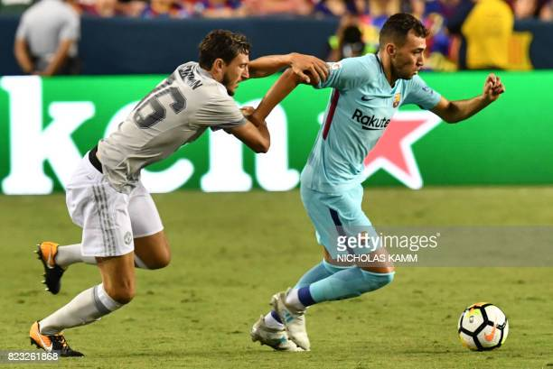 Munir El Haddadi of Barcelona and Matteo Darmian of Manchester United vie for the ball during their International Champions Cup football match on...